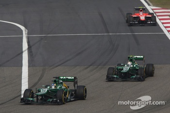 Charles Pic, Caterham CT03 leads team mate Giedo van der Garde, Caterham CT03