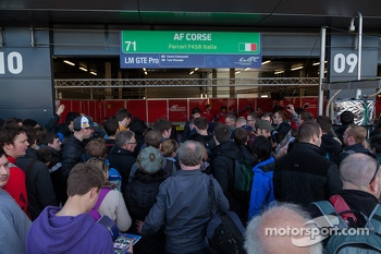 Fans at the AF Corse garage