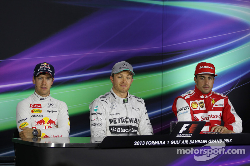 The top three qualifiers in the FIA Press Conference: Fernando Alonso, Ferrari, third; Nico Rosberg, Mercedes AMG F1, pole position; Sebastian Vettel, Red Bull Racing, second