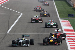 Nico Rosberg, Mercedes AMG F1 W04 and Sebastian Vettel, Red Bull Racing RB9 battle for the lead of the race