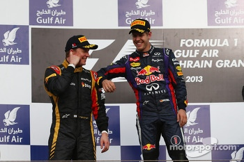 Podium: second place Kimi Raikkonen, Lotus F1 Team with race winner Sebastian Vettel, Red Bull Racing