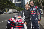 Craig Lowndes drives through the city streets of Perth with Kim Mickle, Olympic javelin thrower