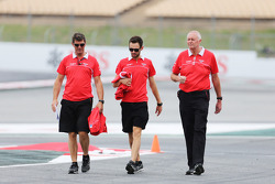 Graeme Lowdon, Marussia F1 Team Chief Executive Officer, and John Booth, Marussia F1 Team Team Principal walk the circuit