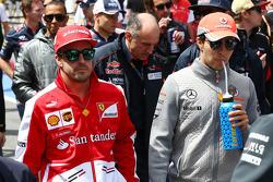 (L to R): Fernando Alonso, Ferrari with Sergio Perez, McLaren