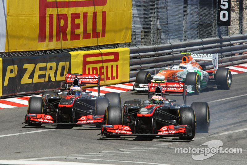 Sergio Perez, McLaren MP4-28 and team mate Jenson Button, McLaren MP4-28 battle for position