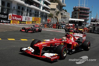 Fernando Alonso, Ferrari F138 passes through as Sergio Perez, McLaren MP4-28 runs wide at the chicane