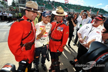 Race winner Sebastian Vettel, Red Bull Racing celebrates with two Canadian Mounted Police