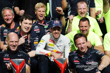 Race winner Sebastian Vettel, Red Bull Racing celebrates with the team