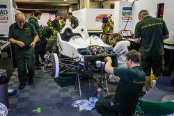 Greaves Motorsport Caterham Motorsport team members repair the heavily damaged #41 Greaves Motorsport Caterham Motorsport Nissan