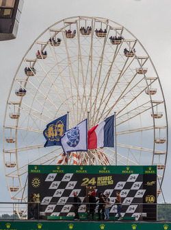 Ferris wheel framing the podium at Le Mans