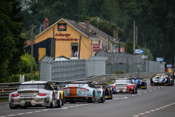 A group of cars follow the safety car during a caution: #88 Proton Competition Porsche 911 GT3-RSR: Christian Ried, Gianluca Roda, Paolo Ruberti