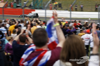 Fans celebrate as Lewis Hamilton, Mercedes AMG F1 W04 takes pole position