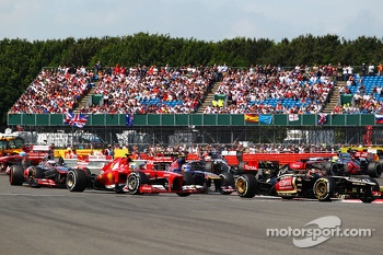 Kimi Raikkonen Lotus F1 E21 leads Felipe Massa Ferrari F138 at the start of the race