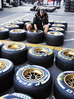 Pirelli tyres prepared by a Lotus F1 Team mechanic