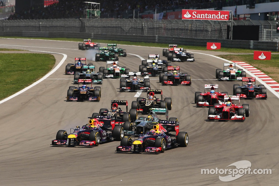 Sebastian Vettel, Red Bull Racing RB9 and Mark Webber, Red Bull Racing RB9 lead at the start of the race