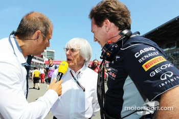 (L to R): Kai Ebel, RTL TV Presenter with Bernie Ecclestone, CEO Formula One Group, and Christian Horner, Red Bull Racing Team Principal