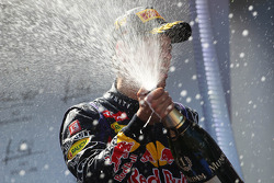 Race winner Sebastian Vettel, Red Bull Racing RB9 celebrates with the champagne on the podium