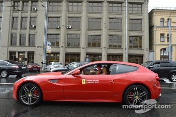 Kamui Kobayashi drives a Ferrari around Moscow