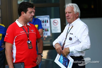 (L to R): Dave O'Neill, Marussia F1 Team Manager with Charlie Whiting, FIA Delegate