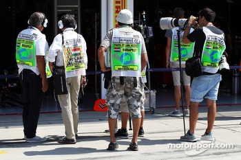 Photographers and Pit Media wearing pit lane tabards