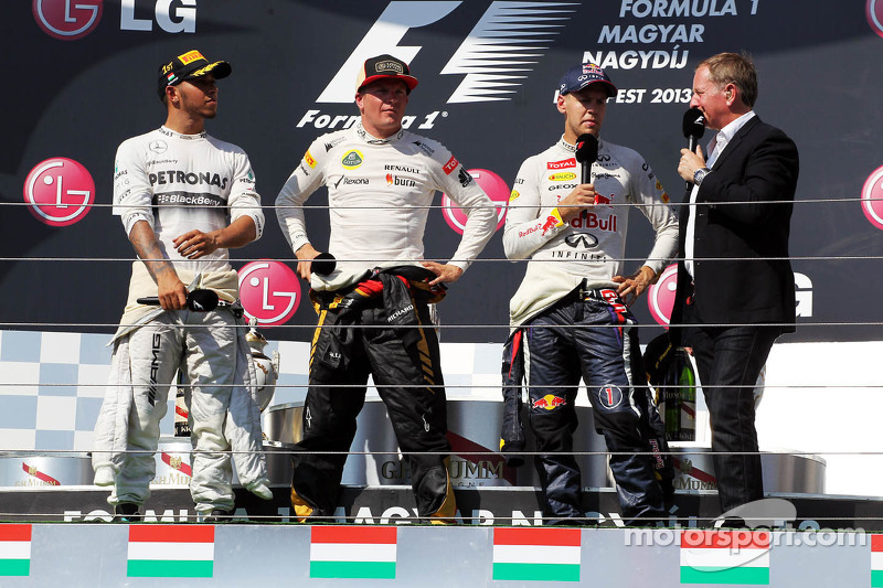 The podium: race winner Lewis Hamilton, Mercedes AMG F1; Kimi Raikkonen, Lotus F1 Team, second; Sebastian Vettel, Red Bull Racing, third; Martin Brundle, Sky Sports Commentator