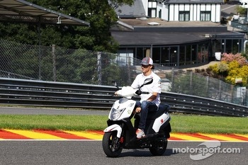 Esteban Gutierrez, Sauber rides the circuit on a moped.