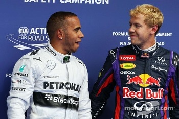 Pole sitter Lewis Hamilton, Mercedes AMG F1 with second placed Sebastian Vettel, Red Bull Racing in parc ferme