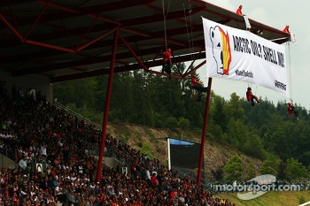 Greenpeace make a protest against race title sponsors Shell on the roof of the main grandstand