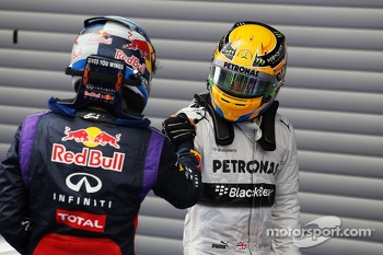 Race winner Sebastian Vettel, Red Bull Racing celebrates with third placed Lewis Hamilton, Mercedes AMG F1 in parc ferme