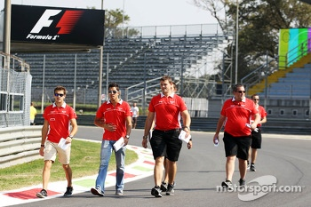 Jules Bianchi, Marussia F1 Team and Rodolfo Gonzalez, Marussia F1 Team Reserve Driver walk the circuit