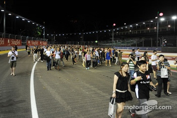 Fans walk the circuit