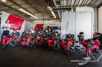 Audi Sport Team Joest team members watch the race