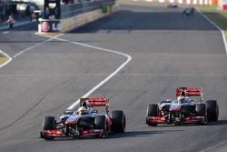 Sergio Perez, McLaren Mercedes and Jenson Button, McLaren Mercedes