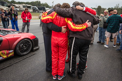 Henrique Cisneros, Eduardo Cisneros, Ramez Wahab and NGT Motorsport team members have a moment of reflexion at the presentation of the #30 NGT Motorsport Porsche 911 GT3 Cup with the Sean Edwards memorial livery