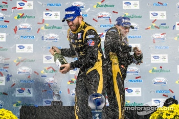 P1 podium: champagne for Nick Heidfeld and Neel Jani