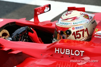 Fernando Alonso, Ferrari F138 with a helmet celebrating his record F1 points haul