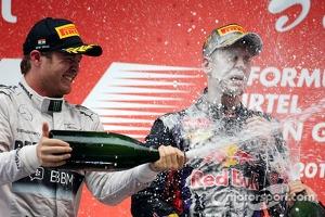 Podium: race winner and 2013 world champion Sebastian Vettel, second place Nico Rosberg