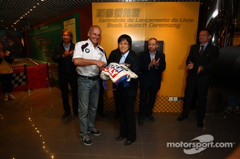 Franz Engstler, BMW E90 320 TC, Liqui Moly Team is donating his overall for the Museum of Macau GP at the presence of Jean Todt, Fia President and all the manager of Macau Grand Prix Committee and Philip Newsome, autohr of the book