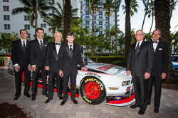 NASCAR Nationwide Series champion owner Roger Penske poses with drivers Brad Keselowski, Ryan Blaney and Joey Logano