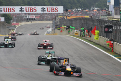 Sebastian Vettel, Red Bull Racing RB9 takes the lead of the race from Nico Rosberg, Mercedes AMG F1 W04