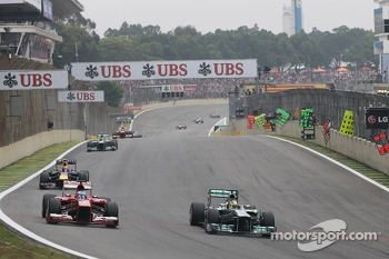 (L to R): Fernando Alonso, Ferrari F138 and Nico Rosberg, Mercedes AMG F1 W04 battle for position
