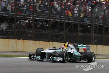 Lewis Hamilton, Mercedes AMG F1 W04 and Mark Webber, Red Bull Racing RB9 battle for position