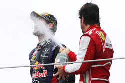 Second place Mark Webber, Red Bull Racing and third place Fernando Alonso, Scuderia Ferrari