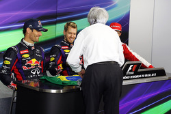 Bernie Ecclestone, CEO Formula One Group, presents a brazilian flag, signed by himself and all the drivers, for Sebastian Vettel, Red Bull Racing to sign, to be presented to Mark Webber, Red Bull Racing