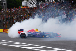 Race winner Sebastian Vettel, Red Bull Racing RB9 celebrates at the end of the race with donuts