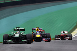 Charles Pic, Caterham CT03 leads Mark Webber, Red Bull Racing RB9