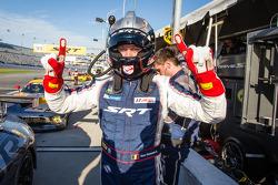 GT pole winner Marc Goossens celebrates
