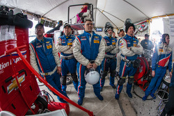 End of the race tension: Action Express Racing team members watch the last minutes of the race at the moment a yellow flag is thrown