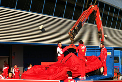 The Ferrari F14-T of Kimi Raikkonen, Ferrari is recovered back to the pits on the back of a truck