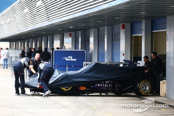 The Red Bull Racing RB10 is wheeled away